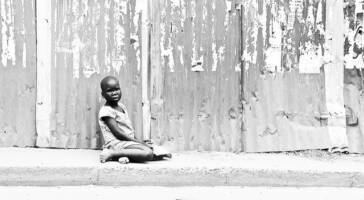A child on the side of the road